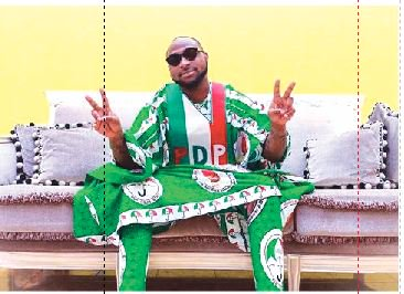 DAVIDO wears PDP Agbada on uncle's campaign