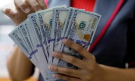 Dollar set for biggest weekly drop in three months