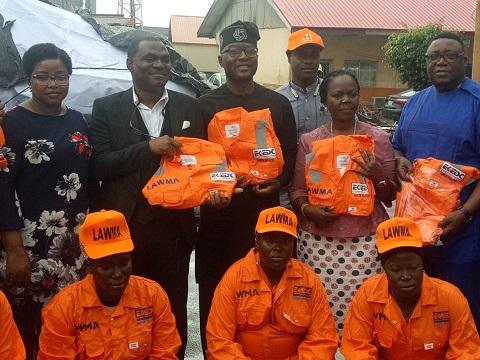 CSR: Eko Disco donates highway sweeper's uniform to LAWMA
