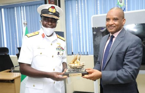 Director General, Nigerian Maritime Administration and Safety Agency (NIMASA) Dr. Bashir Jamoh making a presentation to the Flag Officer Commanding (FOC), Naval Training Command (NAVTRAC), Rear Admiral Fredrick Ogu during a visit by the FOC to the Agency recently.