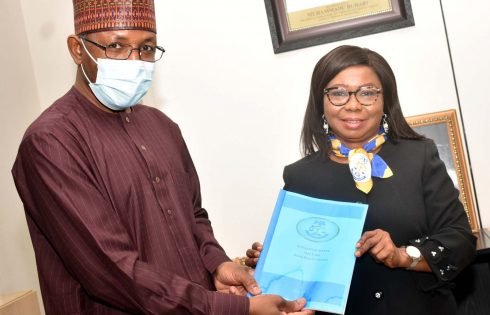 L-R,  Incoming Director General, Securities and Exchange Commission Mr Lamido Yuguda  with Outgoing Acting Director General SEC  Ms Mary Uduk during the Resumption of the New Management of SEC in Abuja Monday