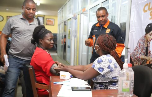 R-L: Abayomi Obadare, General Manager, Billing, Ports & Cargo Handling Services Limited discussing with a medical staff and clearing agent during the 2020 Customer Service Week celebration. Ports & Cargo Handling Services Limited organized a free medical checkup for its clearing agents at the port.