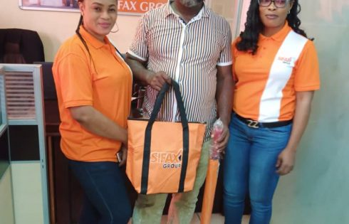 Ada Ihesiaba and Nwaneri Akudo of the Customer Service department of Ports & Cargo Handling Services Limited gifting a customer in celebration of the 2020 Customer Service week celebration held at Ports & Cargo Handling Services Limited.